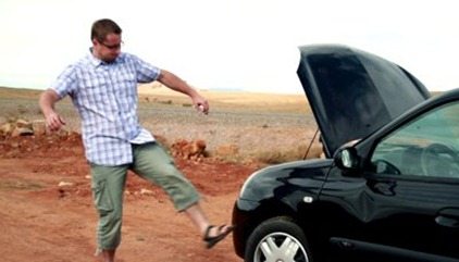 stock-footage-angry-man-on-a-trip-failed-to-repair-broken-car